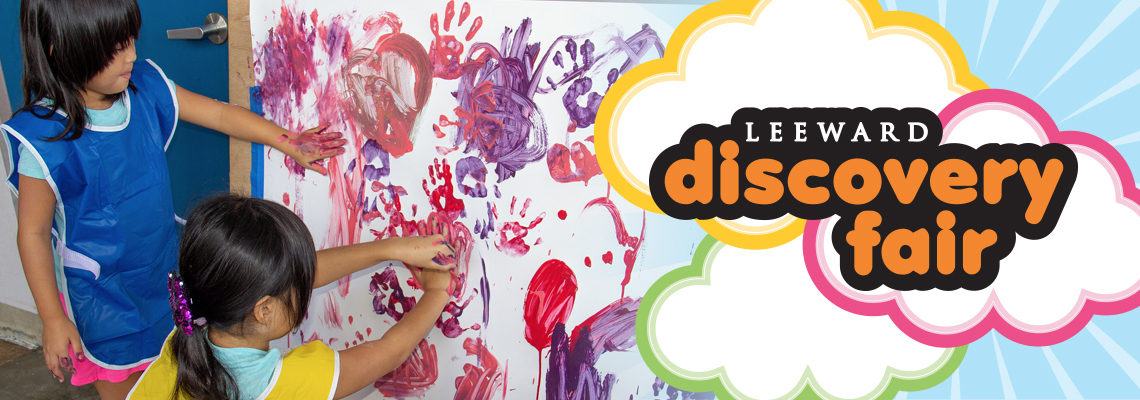 two girls hand painting with discovery fair logo overlay