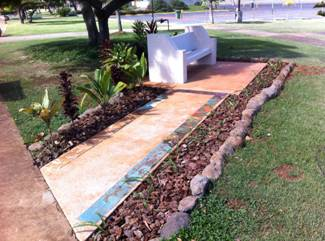 Photo of the Peace Bench with walkway tiles