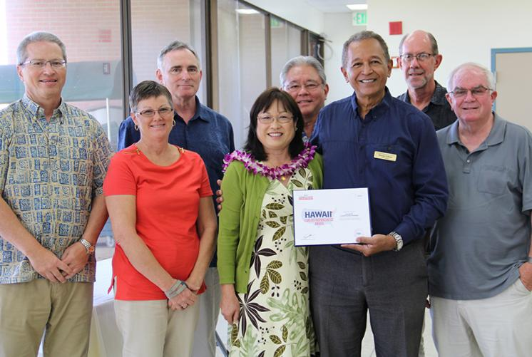 Leeward Admin Team accepts ACT Award.