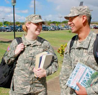 Two students in military uniforms on campus