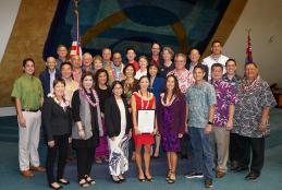 Christina Keaulana, center in red dress, with Hawaii State Legislature