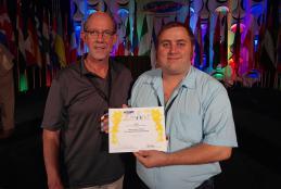 Dean Paul Kuehn and Theatre Manager Kemuel DeMoville accept Pinnacle Award