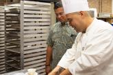 Chef Chris checks the list with Chancellor Penaloza