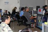 Community members at computers during a session