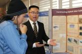 Jeyan Cornelio explains his project to one of the judges