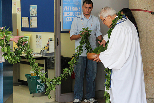 maile lei is ceremonially untied after the blessing of the Vet Resource Center