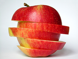 a sliced apple with the slices set at varying angles/></p>