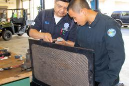 Automotive faculty show equipment to Youth Challenge student