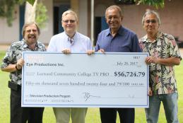 Bob Hochstein, Russel Steele, Manny Cabral and Timmy Chinn with oversized check