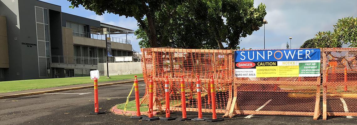 Orange construction fences in parking lot