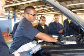 Youth Challenge students go through the routines of an engine check up